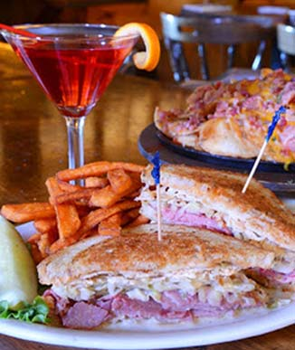 Reuben, sweet potato fries and a drink